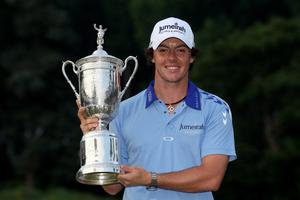 BETHESDA, MD - JUNE 19:  Rory McIlroy of Northern Ireland poses with the trophy after his eight-stroke victory on the 18th green during the 111th U.S. Open at Congressional Country Club on June 19, 2011 in Bethesda, Maryland.  (Photo by Andrew Redington/Getty Images)