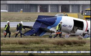 A Team arrives to cut up part of the  mangled wreckage of the aircraft