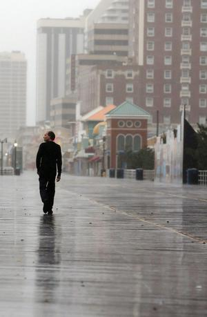 ATLANTIC CITY, NJ - OCTOBER 28:  A man walks on the boardwalk ahead of Hurricane Sandy on October 28, 2012 in Atlantic City, New Jersey.  Governor Chris ChristieÄôs emergency declaration is shutting down the cityÄôs casinos and 30,000 residents are being told to evacuate.    (Photo by Mario Tama/Getty Images)