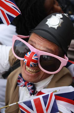 LONDON, ENGLAND - APRIL 29:  A man wears a Union Jack on his nose prior to the Royal Wedding of Prince William to Catherine Middleton at Westminster Abbey on April 29, 2011 in London, England. The marriage of the second in line to the British throne is to be led by the Archbishop of Canterbury and will be attended by 1900 guests, including foreign Royal family members and heads of state. Thousands of well-wishers from around the world have also flocked to London to witness the spectacle and pageantry of the Royal Wedding.  (Photo by Dan Kitwood/Getty Images)
