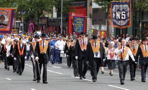 12/7/11 Mandatory Credit Darren Kidd/Presseye.com Orangemen take part in Twelfth of July parades as they make their way to the field at Shaws Bridge, Belfast.The parade makes its way towards the Lisburn Rd, District No 5