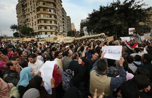 CAIRO, EGYPT - JANUARY 30:  Protestors block the entry of army tanks to Tahrir Square on January 30, 2011 in Cairo, Egypt. Cairo remained in a state of flux and marchers continued to protest in the streets and defy curfew, demanding the resignation of Egyptian president Hosni Mubarek. As President Mubarak struggles to regain control after five days of protests he has appointed Omar Suleiman as vice-president. The present death toll stands at 100 and up to 2,000 people are thought to have been injured during the clashes which started last Tuesday. Overnight it was reported that thousands of inmates from the Wadi Naturn prison had escaped and that Egyptians were forming vigilante groups in order to protect their homes.   (Photo by Peter Macdiarmid/Getty Images)