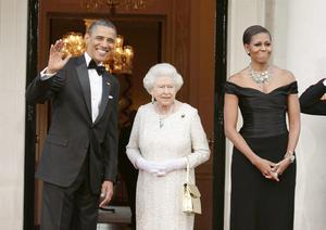 US President Barack Obama and First Lady Michelle Obama welcome the arrival of Queen Elizabeth II at Winfield House - the residence of the Ambassador of the United States of America - in Regent's Park, London, as part of the President's State Visit to the UK. PRESS ASSOCIATION