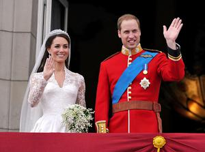 Prince William and his wife Kate Middleton, who has been given the title of The Duchess of Cambridge, wave to the crowd from the balcony of Buckingham Palace, London, following their wedding at Westminster Abbey.  PRESS ASSOCIATION Photo. Picture date: Friday April 29, 2011. See PA story WEDDING Lead. Photo credit should read: John Stillwell/PA Wire