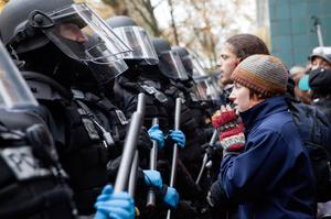 PORTLAND - NOVEMBER 13: A protester pleads with police during a demonstration near the Occupy Portland encampment November 13, 2011 in Portland, Oregon. Portland police have reclaimed the two parks in which occupiers have been camping after a night of brinksmanship with protesting crowds of several thousands. (Photo by Natalie Behring/Getty Images)