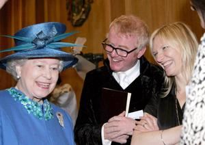 Britain's Queen Elizabeth II meets broadcasters Chris Evans and Jo Whiley (R) during a visit to the BBC's Broadcasting House in London on the day before her 80th birthday. Thursday 20 April, 2006.