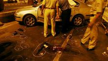 Police officers inspect a car after they shot dead two suspects in Mumbai, India, on late Wednesday night November 26, 2008. Teams of heavily armed gunmen stormed luxury hotels, a popular restaurant, hospitals and a crowded train station in coordinated attacks across India's financial capital Wednesday night, killing at least 78 people and taking Westerners hostage, police said. (AP Photo)