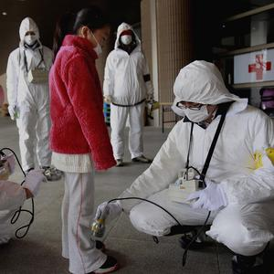 A young evacuee is screened for leaked radiation from the damaged Fukushima nuclear plant (AP)