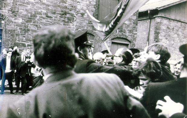 Lord Gerry Fitt, founding member of SDLP and Civil Rights Organiser. Pic shows Gerry Fitt, then a republican MP, is held by police as the Civil Rights demonstrators clash with them in Duke Street, Londonderry. Pic includes nationalist leader Eddie mcAteer (centre) caught up in the struggle. 7/10/1968.