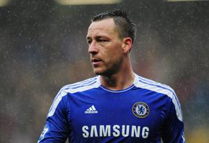 John Terry will appear in court on 9 July on charges of racially abusing Rio Ferdinand's younger brother Anton