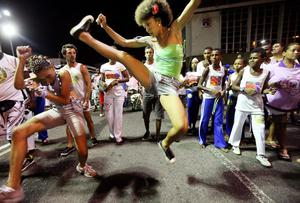 SALVADOR, BRAZIL - FEBRUARY 16:  Brazilians perform capoeira on the first day of Carnival celebrations on February 16, 2012 in Salvador, Brazil. Capoeira is a Brazilian martial art and dance form that was developed by slaves in the region. Carnival is the grandest holiday in Brazil, annually drawing millions in raucous celebrations culminating on Fat Tuesday before the start of the Catholic season of Lent beginning on Ash Wednesday. Salvador is the capital of the Northeastern state of Bahia and was the first colonial capital of Brazil. Police strikes in Salvador and Rio de Janiero in recent weeks threatened Carnival and raised questions about the countryÄôs preparedness to host the upcoming 2014 World Cup and 2016 Summer Olympics. Rio de JanieroÄôs Carnival begins tomorrow. (Photo by Mario Tama/Getty Images)