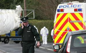 A police officers patrols at the Massereene army barracks in Antrim, west of Belfast, Northern Ireland Sunday, March, 8, 2009 after two British soldiers were shot to death and four other people wounded in a drive-by ambush that politicians blamed on IRA dissidents. Suspected IRA dissidents who opened fire on British soldiers and pizza delivery men outside an army base shot their victims again as they lay wounded on the ground, police said Sunday. Two soldiers died and four other people, including two men delivering pizzas, remained hospitalized with serious wounds following Saturday night's attack at the entrance to Massereene army barracks in Antrim, west of Belfast.  (AP Photo/Peter Morrison)  (AP Photo/Peter Morrison)