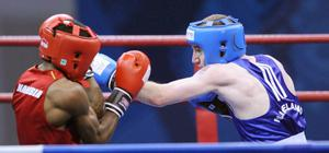 Northern Ireland's Paddy Barnes (blue) competes against Namibia's Jafet Uutoni in the light fly weight final during Day Ten of the 2010 Commonwealth Games