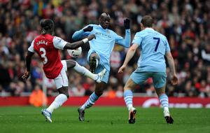 LONDON, ENGLAND - APRIL 08:  Mario Balotelli of Man City clashes with Bacary Sagna of Arsenal during the Barclays Premier League match between Arsenal and Manchester City at Emirates Stadium on April 8, 2012 in London, England.  (Photo by Michael Regan/Getty Images)