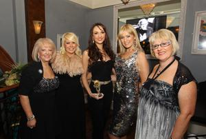 Model of the Year Ciara McStravick with Valerie Kirkpatrick, Joleen McKee, Alison Campbell and  Louise Roe at the Alison Campbell Modelling Agency Christmas Party at Cafe Vaudeville. Picture by Kelvin Boyes / PressEye.com