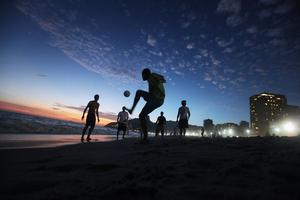 RIO DE JANEIRO, BRAZIL - FEBRUARY 18:  Brazilian revelers play soccer at sunset during Carnival celebrations along Ipanema beach on February 18, 2012 in Rio de Janiero, Brazil. Carnival is the grandest holiday in Brazil, annually drawing millions in raucous celebrations culminating on Fat Tuesday before the start of the Catholic season of Lent which begins on Ash Wednesday. Police strikes in Salvador and Rio de Janiero in recent weeks threatened Carnival and raised questions about the countryÄôs preparedness to host the upcoming 2014 World Cup and 2016 Summer Olympics.   (Photo by Mario Tama/Getty Images)