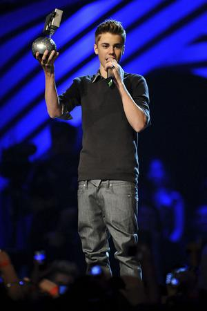 BELFAST, NORTHERN IRELAND - NOVEMBER 06:  Singer Justin Bieber receives the award for Best Pop onstage during the MTV Europe Music Awards 2011 live show at at the Odyssey Arena on November 6, 2011 in Belfast, Northern Ireland.  (Photo by Ian Gavan/Getty Images)