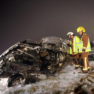 Firefighters examine a Cessna that crash-landed on the tarmac in foggy conditions at Birmingham Airport (West Midlands Fire Service/PA)