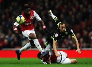 LONDON, ENGLAND - JANUARY 09:  Andros Townsend (R) of Leeds United is challenged by Francis Coquelin (C) and Alex Song (L) of Arsenal during the FA Cup Third Round match between Arsenal and Leeds United at the Emirates Stadium on January 9, 2012 in London, England.  (Photo by Clive Mason/Getty Images)