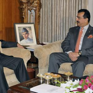 Pakistan prime minister Yousuf Raza Gilani (right) talks with president Asif Ali Zardari during a meeting at President House in Islamabad (AP)