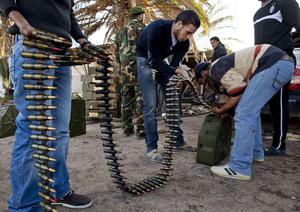 Libyan militia members who are now part of the forces against Libyan leader Moammar Gadhafi organize ammunition at a military base in Benghazi, in eastern Libya, Monday, Feb. 28, 2011. (AP Photo/Kevin Frayer)