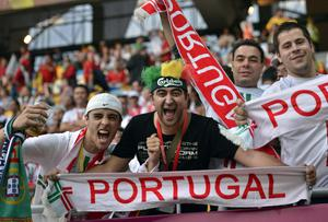 Portuguese fans cheer before the Euro 2012 soccer championship Group B match between Germany and Portugal in Lviv, Ukraine, Saturday, June 9, 2012. (AP Photo/Martin Meissner)