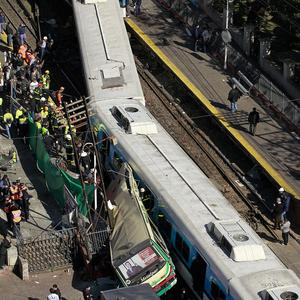 The wreckage of the crash between two passenger trains and a bus in Buenos Aires, Argentina, caused by the bus driver trying to beat the train to a crossing(AP)