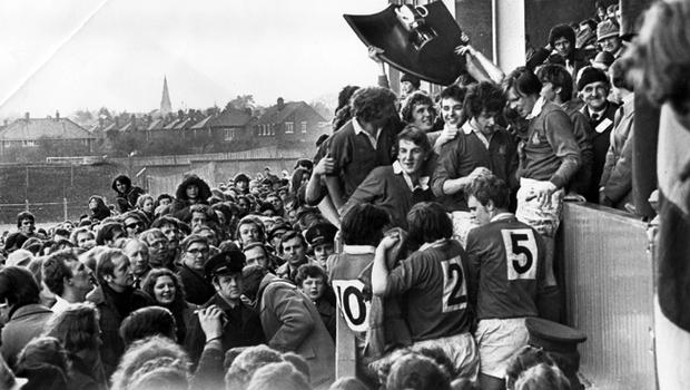 Bangor Grammar School players and supporters begin their celebrations as the famous shield and cup is handed over at Ravenhill after their 17-9 victory over Annadale. 18/3/1978