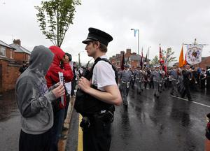 Press Eye Belfast - Northern Ireland -  Tuesday 12th  July 2011 -  Bandsmen and members of the Orange Order pass Nationalist Protestors at a contentious flashpoint in Ardoyne, north Belfast as part of the annual 12th July parades across Northern Ireland.Nationalist protestors watch a flute band march pastPicture by Kelvin Boyes / Press Eye.
