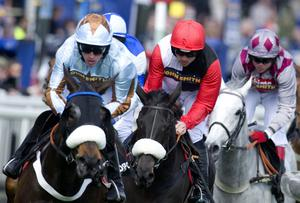 LIVERPOOL, ENGLAND - APRIL 12:  Ruby Walsh riding Big Buck's (C) on their way to winning The BGC Partners Liverpool Hurdle Race to complete a straight 17 victories in a row at Aintree racecourse on April 12, 2012 in Liverpool, England. (Photo by Alan Crowhurst/Getty Images)