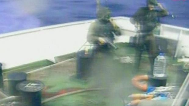 Image released by the Turkish Aid group IHH Monday May 31, 2010 purports to show Israeli soldiers aboard a military vessel in international waters off the Gaza