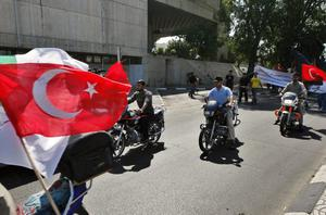 Palestinian Islamic Jihad supporters hold Turkish flags as they ride on their motorcycles during a protest in Gaza City, Monday, May 31, 2010.