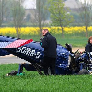 Investigators looks at wreckage of the light aircraft that crashed at Hinton-in-the-Hedges airfield, near Brackley
