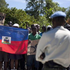 Hundreds of protesters blaming UN peacekeepers for Haiti's widening cholera epidemic march on a military base (AP)