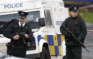 Police Service of Northern Ireland officers take up  position near Lismore Manor, Craigavon, Northern Ireland, Tuesday, March, 10, 2009. A large security presence has begun after a Police Service of Northern Ireland officer was shot dead by suspected Irish Republican terrorists.  (AP Photo/Peter Morrison)