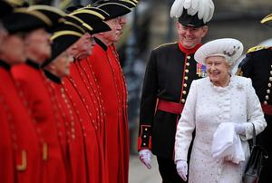 Royal rumpus: The Queen is greeted by Chelsea pensioners yesterday while Martin McGuinness (below) may shake the monarch's hand