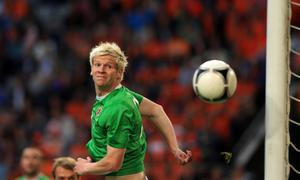 Northern Ireland's Ryan McGivern clears the ball