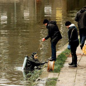 Police divers in Regent's Canal in Camden, north London, where bags containng body parts of Paula Fields were found