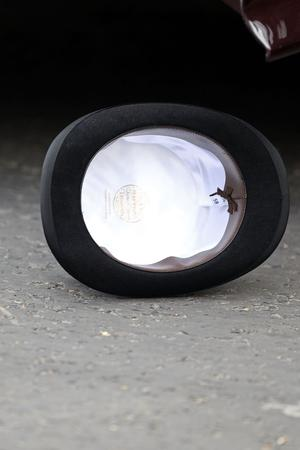 LONDON, ENGLAND - APRIL 29:  The top hat of Michael Middleton fallen to the ground as he steps out of the car to attend the Royal Wedding of his daughter Catherine Middleton to Prince William of Wales at Westminster Abbey on April 29, 2011 in London, England. The marriage of the second in line to the British throne is to be led by the Archbishop of Canterbury and will be attended by 1900 guests, including foreign Royal family members and heads of state. Thousands of well-wishers from around the world have also flocked to London to witness the spectacle and pageantry of the Royal Wedding.  (Photo by Chris Jackson/Getty Images)