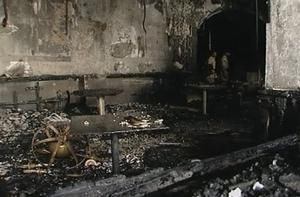 In this image taken from television, the burnt-out interior of a room of Taj Mahal Hotel is seen in Mumbai, India, Saturday, Nov. 29, 2008.  Indian commandos killed the last remaining gunmen holed up at the luxury Mumbai hotel Saturday, ending a 60-hour rampage through India's financial capital by suspected Islamic militants that killed people and rocked the nation. (AP Photo/APTN)