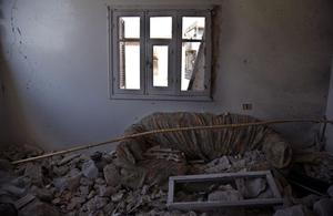 In this Sunday Aug. 5, 2012 photo, a couch is seen  in a damaged room in a destroyed house in town of Atareb on the outskirts of Aleppo, Syria. (AP Photo)