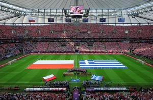 WARSAW, POLAND - JUNE 08: The teams line up ahead of the UEFA EURO 2012 group A match between Poland and Greece at The National Stadium on June 8, 2012 in Warsaw, Poland.  (Photo by Shaun Botterill/Getty Images)