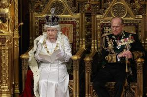 Queen Elizabeth II, accompained by Prince Philip, the Duke of Edinburgh, delivers her speech in the House of Lords during the State Opening of Parliament on May 9, 2012 in London, England.  (Photo by Oli Scarff - WPA Pool/Getty Images)