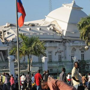 People gather outside Haiti's quake-damaged National Palace (AP/Jorge Cruz)