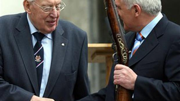 95. Newly appointed First Minister Dr Ian Paisley, left, presents a 300 year-old musket to Irish Prime Minister Bertie Ahern at the Battle of the Boyne site, Drogheda, Ireland, Friday, May, 11, 2007. The pair visited the site of the famous Battle of the Boyne 1690 between the Protestant King William of Orange and the Catholic King James's army.