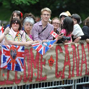 Well-wishers outside Rideau Hall in Ottawa, Canada, wait for the arrival of the Duke and Duchess of Cambridge