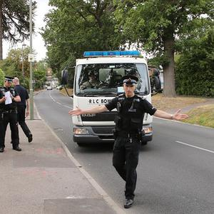 A Royal Logistic Corps bomb disposal truck arrives at the cordon close to the home of Saad al-Hilli in Claygate, Surrey