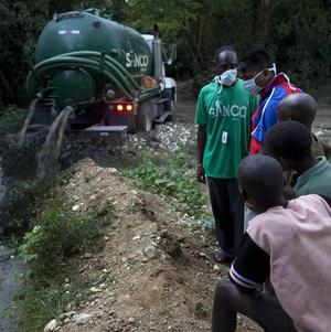 A tanker truck deposits excrement from the Nepali UN base in an area just 400 metres away from Mirebalais, Haiti