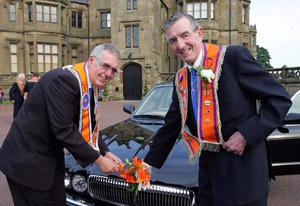 Making sure that the orange lillies were tightly secured on their car were, Boyne Star LOL 16 members David Johnston (left) and Harry Collins who was parading the Twelfth through Lurgan for his 59th year in succession!. Picture By Rick Hewitt. 12/7/11.