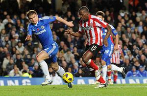 Sunderland's Nedum Onuoha (second right) takes on Chelsea's Branisalv Ivanovic as he goes on to score the opening goal during the Barclays Premier League match at Stamford Bridge, London. PRESS ASSOCIATION Photo. Picture date: Sunday November 14, 2010. See PA Story SOCCER Chelsea. Photo credit should read: Rebecca Naden/PA Wire. RESTRICTIONS: Use subject to restrictions. Editorial print use only except with prior written approval. New media use requires licence from Football DataCo Ltd. Call +44 (0)1158 447447 or see www.pressassociation.com/images/restrictions for full restrictions.